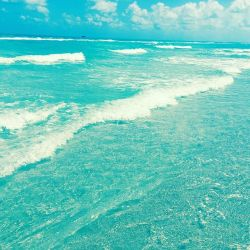 A photograph of clear ocean water on Miami Beach.