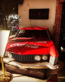 A picture of an Old red car in Miami Beach
