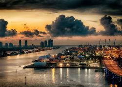 A photo of The port of Miami and Miami Beach at twilight.