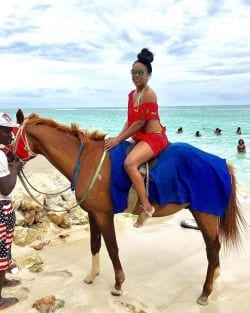 A picture of a woman Horse back ring on the beach in St. Lucia